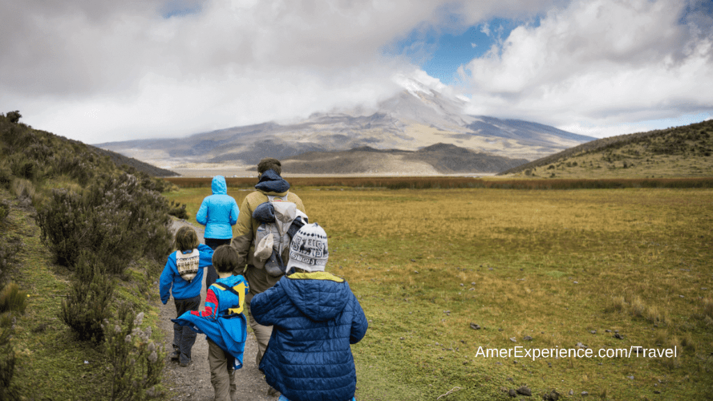 Family hiking at the base of volcano Cotopaxi in Ecuador